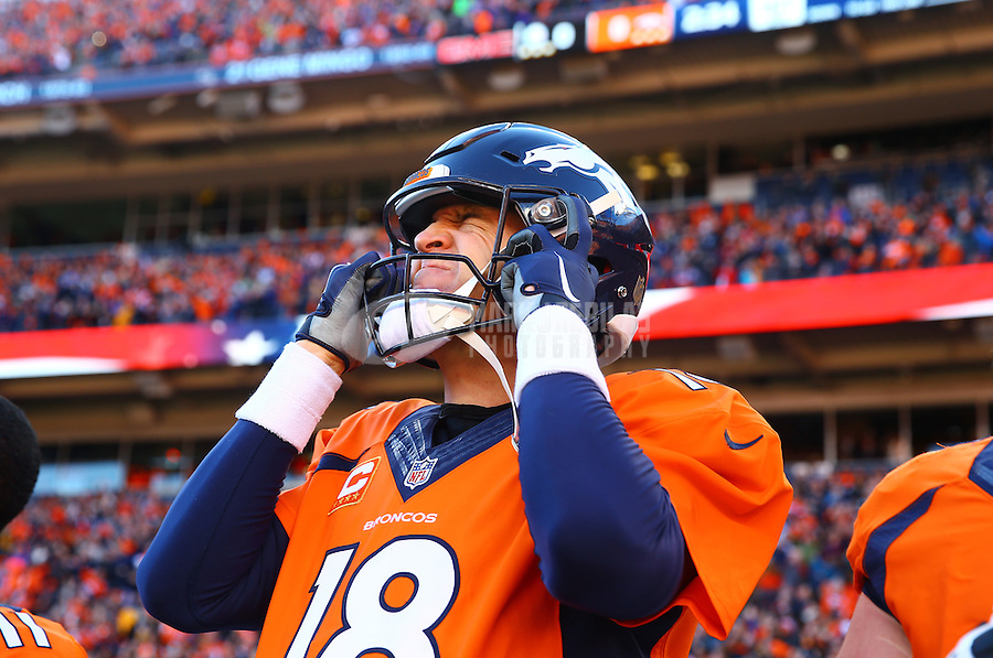 Jan 17, 2016; Denver, CO, USA; Denver Broncos quarterback Peyton Manning (18) reacts as he puts on his helmet against the Pittsburgh Steelers during the AFC Divisional round playoff game at Sports Authority Field at Mile High. Mandatory Credit: Mark J. Rebilas-USA TODAY Sports