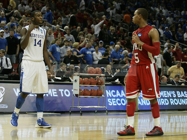 Former high school teammates Michael Kidd-Gilchrist and Derrick Gordon reunited for a moment after University of Kentucky defeated Western Kentucky University 81-66 in the second round of the NCAA Tournament, in the KFC Yum! Center, on Thursday, March 15, 2012 in Louisville, Ky.  Kidd-Gilchrist told Gordon to call him as they walked off the court.  Photo by Latara Appleby | Staff ..
