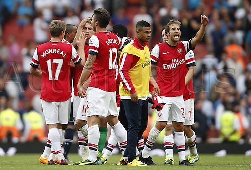 02.09.2013 London, England. Mathieu Flamini Celebrates with teammates after The Barclays Premier League Match between Arsenal and Tottenham Hotspur at the Emirates Stadium.