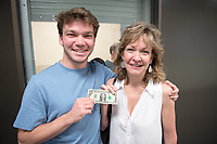 On this #FridayThe13th, Teresa Ritter flew from Great Falls, Montana to see her son, Donovan Dennis '16, as he prepares for #commencement, but also to bring back a lucky dollar bill she found four years ago near #GilmanFountain on their first trip to Oxy.<br /> Today, May 13, 2016, Teresa used that very same sawbuck to pay Donovan's late fee for a computer he checked out — sustainability in action.<br /> (Photo by Marc Campos, Occidental College Photographer)