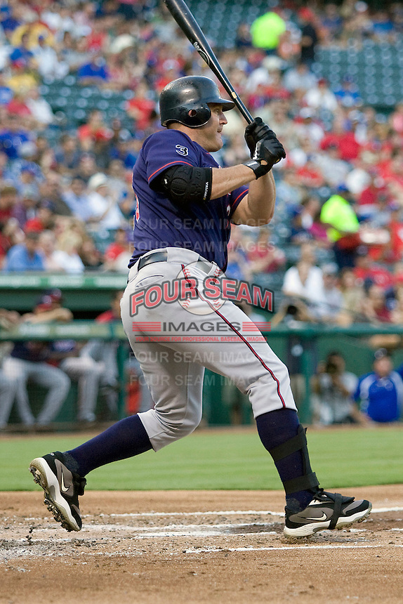 Minnesota Twins designated hitter Jim Thome #25 follows through during a Major League Baseball game against the Texas Rangers at the Rangers Ballpark in Arlington, Texas on July 27, 2011. Minnesota defeated Texas 7-2.  (Andrew Woolley/Four Seam Images)