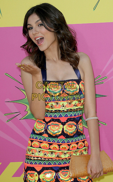 Victoria Justice.at The Nickelodeon's Kids' Choice Awards 2013 held at The Galen Center in Los Angeles, California, USA,.March 23rd 2013.half length yellow green print halterneck mini dress hand blowing kiss gesture   orange open toe navy blue sequined sequin clutch bag .CAP/ADM.©AdMedia/Capital Pictures.