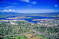 Aerial shot of Pearl Harbor, Fort Island and the Waianae mountain range on a clear day.