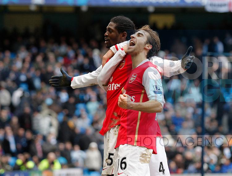Emmanuel Adebayor of Arsenal and Mathieu Flamini of Arsenal celebrate the third goal