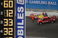 Feb. 28, 2009; Las Vegas, NV, USA; NASCAR Nationwide Series driver Michael Annett climbs from his car after crashing during the Sam's Town 300 at Las Vegas Motor Speedway. Mandatory Credit: Mark J. Rebilas-