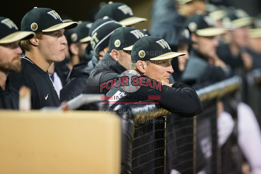 Wake Forest Demon Deacons volunteer assistant Joey Hammond (29) watches the action from the dugout in game two of a double-header against the Kent State Golden Flashes at David F. Couch Ballpark on March 4, 2017 in Winston-Salem, North Carolina.  The Demon Deacons defeated the Golden Flashes 5-0.  (Brian Westerholt/Four Seam Images)