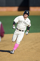 Nate Mondou (10) of the Wake Forest Demon Deacons hustles towards third base against the Virginia Tech Hokies at Wake Forest Baseball Park on March 7, 2015 in Winston-Salem, North Carolina.  The Hokies defeated the Demon Deacons 12-7 in game one of a double-header.   (Brian Westerholt/Four Seam Images)