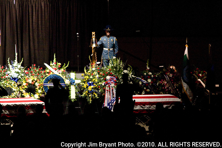 A bell is rung 21 times during a memorial service at the Tacoma Dome on December 8, 2009 in Tacoma, WA. Tina Griswold along with sergeant Mark Renninger, officer Ronald Owens and officer Greg Richards were shot and killed at a coffee shop in the Tacoma suburb of Parkland, November 29 by Maurice Clemmons, who was later shot and killed by police. Jim Bryant Photo. ©2010. ALL RIGHTS RESERVED.