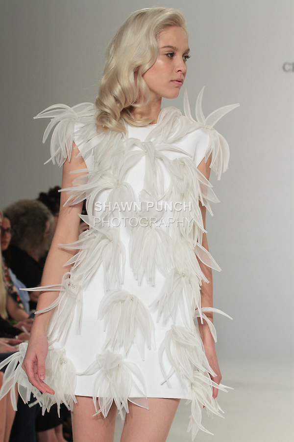 Model walks runway in an appliqué mini dress, from the Christian Siriano for Kleinfeld bridal collection, at Kleinfeld on April 18, 2016 during New York Bridal Fashion Week Spring Summer 2017.