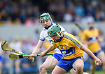 Kealan Guyler of Clare  in action against Sam Fitzgerald of Waterford during their Munster  championship round robin game at Cusack Park Photograph by John Kelly.