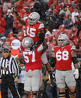Ohio State Buckeyes running back Ezekiel Elliott (15) celebrates his touchdown with Ohio State Buckeyes offensive lineman Chase Farris (57) in the second quarter of the college football game between the Ohio State Buckeyes and the Michigan State Spartans at Ohio Stadium in Columbus, Saturday afternoon, November 21, 2015. As of half time the Ohio State Buckeyes and the Michigan State Spartans were tied 7 - 7. (The Columbus Dispatch / Eamon Queeney)