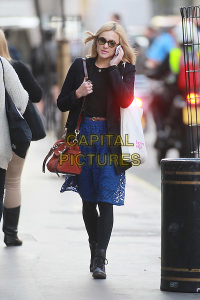 Fearne Cotton arriving at the studios of BBC Radio 1, London, England..October 20th, 2011.full length black boots tights blue lace skirt coat red bag purse sunglasses shades talking on mobile phone.CAP/HIL.©John Hillcoat/Capital Pictures.