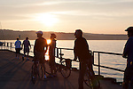 Tourists and locals bike in Open Space Park, Lake Michigan, Traverse City, Michigan, MI, USA