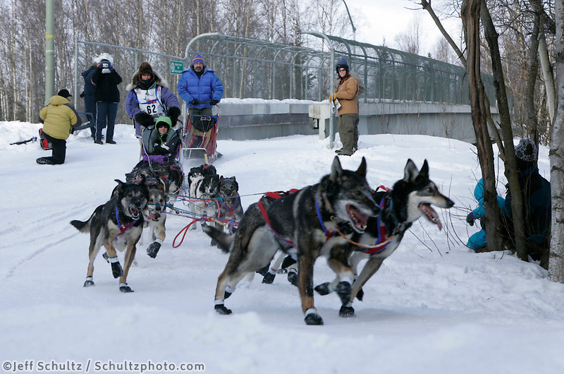 Molly Yazwinski rounds a turn in Anchorage on Saturday March 1st during the ceremonial start day of the 2008 Iidtarod Sled Dog Race.