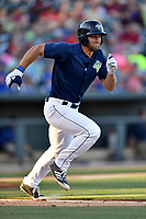 Left fielder Tim Tebow (15) of the Columbia Fireflies runs toward first in a game against the West Virginia Power on Friday, May 19, 2017, at Spirit Communications Park in Columbia, South Carolina. West Virginia won, 3-1. (Tom Priddy/Four Seam Images)