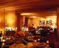 The dining and living rooms are inter-connected and create a cosy, romantic space at night when lit with candles and lamps