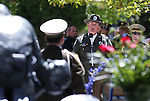 Storey County Sheriff's Deputy Shawn Mahan sings at the annual Law Enforcement Officers Memorial ceremony on Thursday, May 1, 2014, in Carson City, Nev. (Las Vegas Review-Journal/Cathleen Allison)