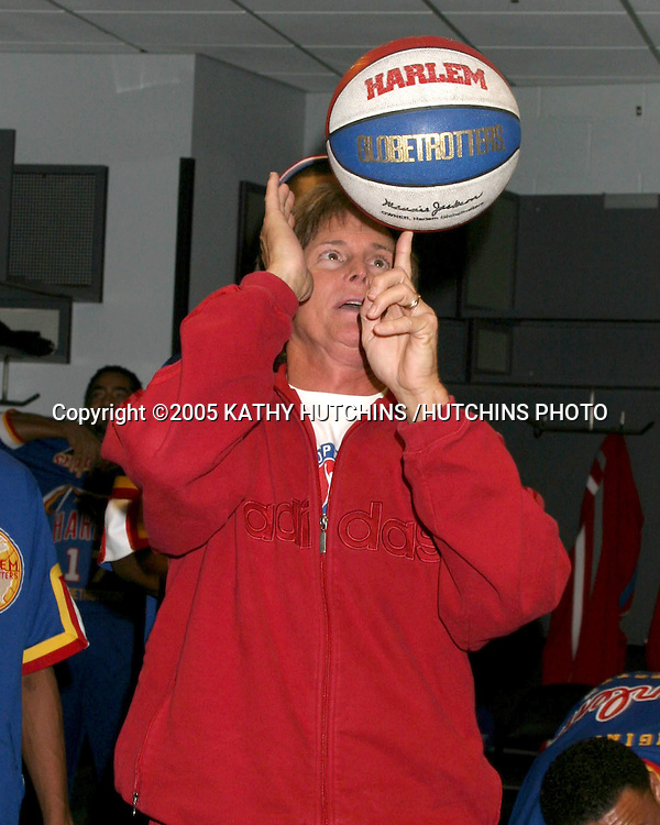 BRUCE JENNER AND THE GLOBETROTTER BACKSTAGE, SPINNING TRICKS - HE DID HIS OWN TRICKS!.CELEBRITIES ATTEND.HARLEM GLOBETROTTERS GAME AT .THE STAPLES CENTER.LOS ANGELES, CA.FEBRUARY 21, 2005.©2005 KATHY HUTCHINS /HUTCHINS PHOTO..EXCLUSIVE