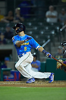 Grant Fennell (5) of the Myrtle Beach Pelicans follows through on his swing against the Winston-Salem Dash at TicketReturn.com Field on May 16, 2019 in Myrtle Beach, South Carolina. The Dash defeated the Pelicans 6-0. (Brian Westerholt/Four Seam Images)