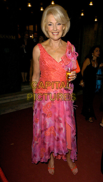 DIANA MORANNATASHA KAPLINSKY .Breast Cancer Care 2006 Fashion Show arrivals.Grosvenor House Hotel, London, England .October 4th, 2006.Ref: CAN.full length pink purple skirt top floral print drink champagne.www.capitalpictures.com.sales@capitalpictures.com.©Can Nguyen/Capital Pictures