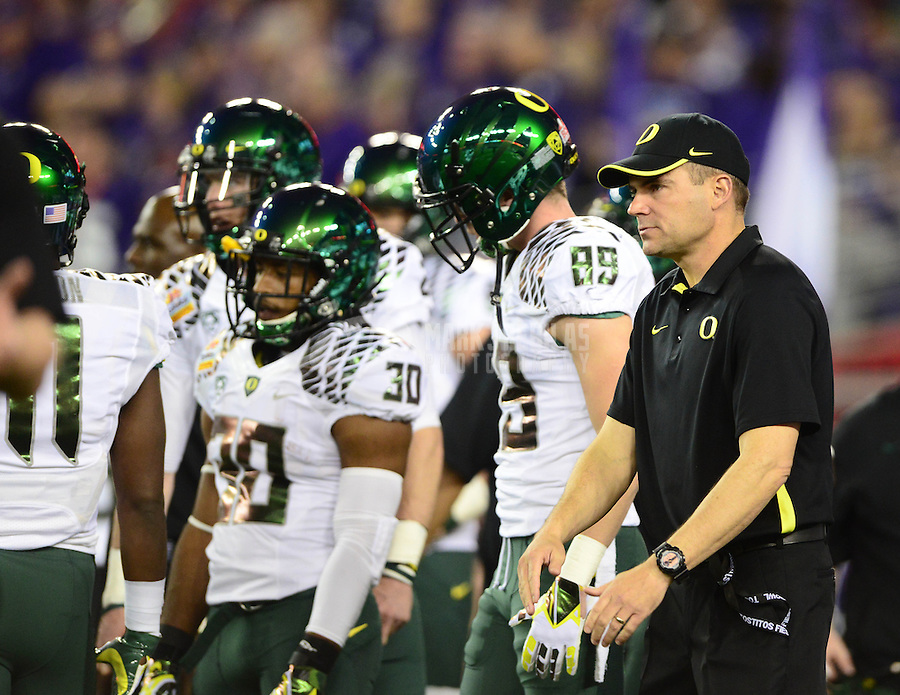 Jan. 3, 2013; Glendale, AZ, USA: Oregon Ducks offensive coordinator Mark Helfrich (right) against the Kansas State Wildcats during the 2013 Fiesta Bowl at University of Phoenix Stadium. Mandatory Credit: Mark J. Rebilas-