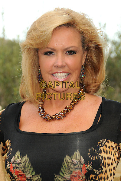 Mary Murphy<br /> 6th Annual Oceana SeaChange Gala held at a Private Villa, Laguna Beach, California, USA. <br /> August 18th, 2013<br /> headshot portrait necklace beads beige green orange pink purple print tropical leopard <br /> CAP/ADM/BP<br /> &copy;Byron Purvis/AdMedia/Capital Pictures