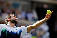 Marin Cilic of Croatia serves to Roger Federer of Switzerland during men semifinal match at the US Open 2014 tennis tournament in the USTA Billie Jean King National Center, New York.  09.05.2014. VIEWpress