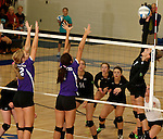 SIOUX FALLS, SD - SEPTEMBER 25: Anne McCabe #12 and Shayla Johnson #1 from Dakota Valley try for a block on Sydney Korn #7 from Sioux Falls Christian in the first game of their match Thursday night at Sioux Falls Christian High.  (Photo by Dave Eggen/Inertia)