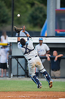 Princeton Rays catcher Rafelin Lorenzo (8) catches a pop fly during the game against the Burlington Royals at Burlington Athletic Stadium on June 24, 2016 in Burlington, North Carolina.  The Rays defeated the Royals 16-2.  (Brian Westerholt/Four Seam Images)