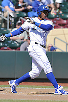 Jimmy Parades #17 of the Omaha Storm Chasers swings against the Memphis Redbirds at Werner Park on April 9, 2014 in Omaha, Nebraska. The Storm Chasers beat the Redbirds 20-3.   (Dennis Hubbard/Four Seam Images)