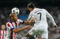 Real Madrid´s Portuguese forward Cristiano Ronaldo and Atletico Madrid´s Brazilian defense Joao Miranda