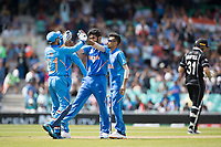 Dinesh Karthik (India) congratulates Jasprit Bumrah (India) on the wicket of Munro during India vs New Zealand, ICC World Cup Warm-Up Match Cricket at the Kia Oval on 25th May 2019