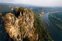 """The view from the """"Bastei"""" (Bastion) over the Elbe Sandstone (lime stone) Mountains and the Elbe river down below is breathtaking."""