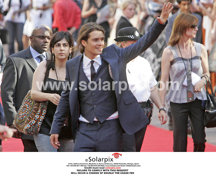 ALL ROUND PICTURES FROM SOLARPIX.COM. .**NO PUBLICATION IN FRANCE, SCANDANAVIA, AUSTRALIA AND GERMANY** NO UK NEWSPAPER PUBLICATION - UK MAGAZINES ONLY**.Orlando Bloom arrives for the Pirates Of The Caribbean 2: Dead Man's Chest UK film premiere at the Odeon Leicester Square, London on 03.07.06. Job Ref: 2541/SFE..MUST CREDIT SOLARPIX.COM OR DOUBLE FEE WILL BE CHARGED..