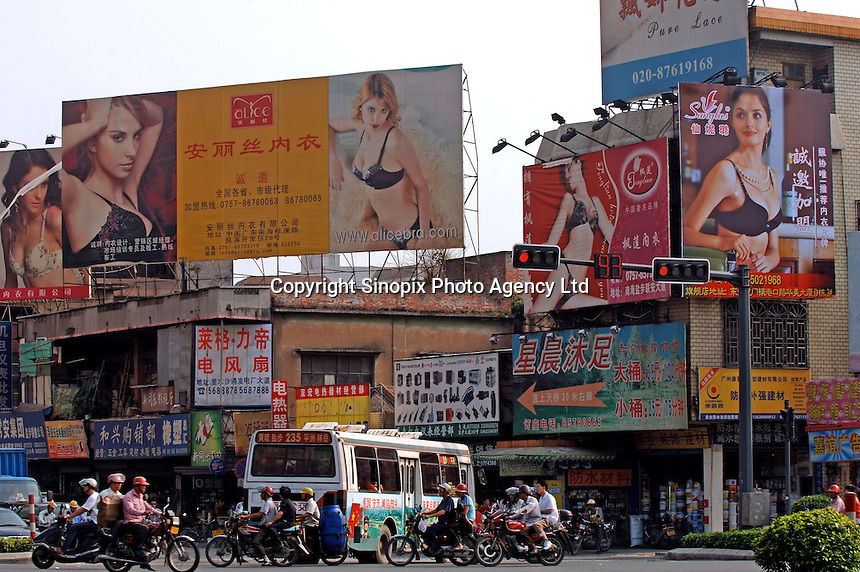 Billboards from some of the 100 factories at the International Underwear City, Yanbu Town, Nanhai District, Foshan City, Guangdong, China.  Jealousy produces 11 million bras annually and is increasing...PHOTO BY SINOPIX