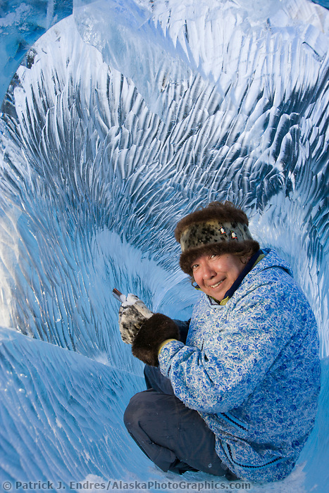 "Ice Artist Kathleen Carlo sculpts lays inside here sculpture ""soul catcher"" and chisels texture into the long tube made of ice.Ice Artist Kathleen Carlo sculpts lays inside here sculpture ""soul catcher"" and chisels texture into the long tube made of ice."