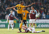 Burnley's Ashley Barnes is grounded following the challenge from Wolverhampton Wanderers' Romain Saiss<br /> <br /> Photographer Rich Linley/CameraSport<br /> <br /> The Premier League - Burnley v Wolverhampton Wanderers - Saturday 30th March 2019 - Turf Moor - Burnley<br /> <br /> World Copyright © 2019 CameraSport. All rights reserved. 43 Linden Ave. Countesthorpe. Leicester. England. LE8 5PG - Tel: +44 (0) 116 277 4147 - admin@camerasport.com - www.camerasport.com