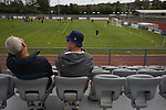 Guernsey 0 Corinthian-Casuals 1, 10/09/2017. Footes Lane, Isthmian League Division One. Two fans watching the players warming-up as Guernsey take on Corinthian-Casuals in a Isthmian League Division One South match at Footes Lane. Formed in 2011, Guernsey FC are a community club located in St. Peter Port on the island of Guernsey and were promoted to the Isthmian League Division One South in 2013. The visitors from Kingston upon Thames won the fixture by 1-0, watched by a crowd of 614 spectators. Photo by Colin McPherson.