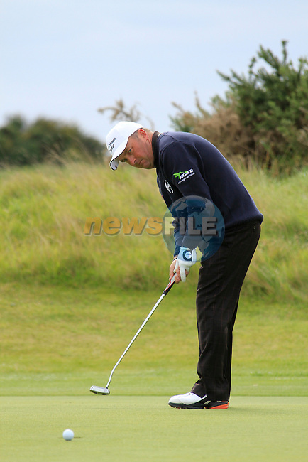 Damien McGrane putts on the 13th green during Day 3 of the 100th Irish PGA championship at Seapoint Golf Club, Co Louth...Picture Eoin Clarke/www.golffile.ie.