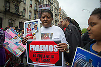 Hundreds march through the streets of the South Bronx in  New York for the Moms Demand Action for Gun Sense Hundreds march through the streets of the South Bronx in  New York for the Moms Demand Action for Gun Sense march and rally on Saturday, May 11, 2013. The event pays tribute to mothers of gun violence victims during the Mother's Day weekend and calls on elected officials to pass gun reform legislation.  Many of the participants carried bouquets of eight handmade paper flowers to represent the eight children killed by gun violence every day in the United States. (© Frances M. Roberts)