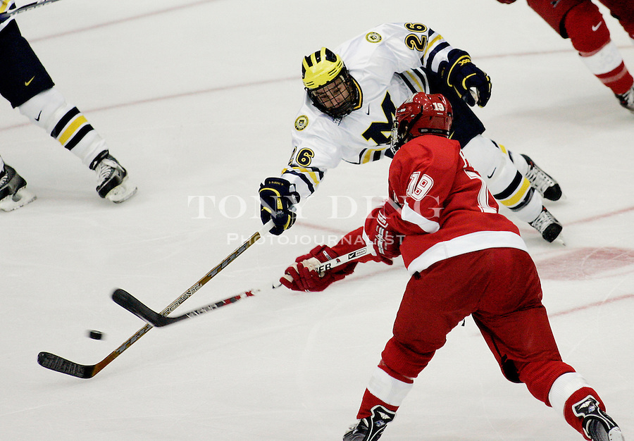 19 October 2006: Michigan forward Danny Fardig (26) dives to block a shot by Miami forward forward Jarod Palmer (19) during Michigan's 6-3 win in their CCHA season opener against Miami (OH) at Yost Ice Arena in Ann Arbor, MI.