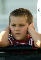 Sept. 19, 2010; Concord, NC, USA; A young NHRA fan plugs his ears during the O'Reilly Auto Parts NHRA Nationals at zMax Dragway. Mandatory Credit: Mark J. Rebilas-