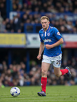 Matthew Clarke of Portsmouth on the ball during the Sky Bet League 2 match between Portsmouth and Wycombe Wanderers at Fratton Park, Portsmouth, England on 23 April 2016. Photo by Andy Rowland.