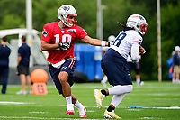 July 27, 2017: New England Patriots quarterback Jimmy Garoppolo (10) hands off the ball to running back Brandon Bolden (38) at the New England Patriots training camp held on the practice field at Gillette Stadium, in Foxborough, Massachusetts. Eric Canha/CSM