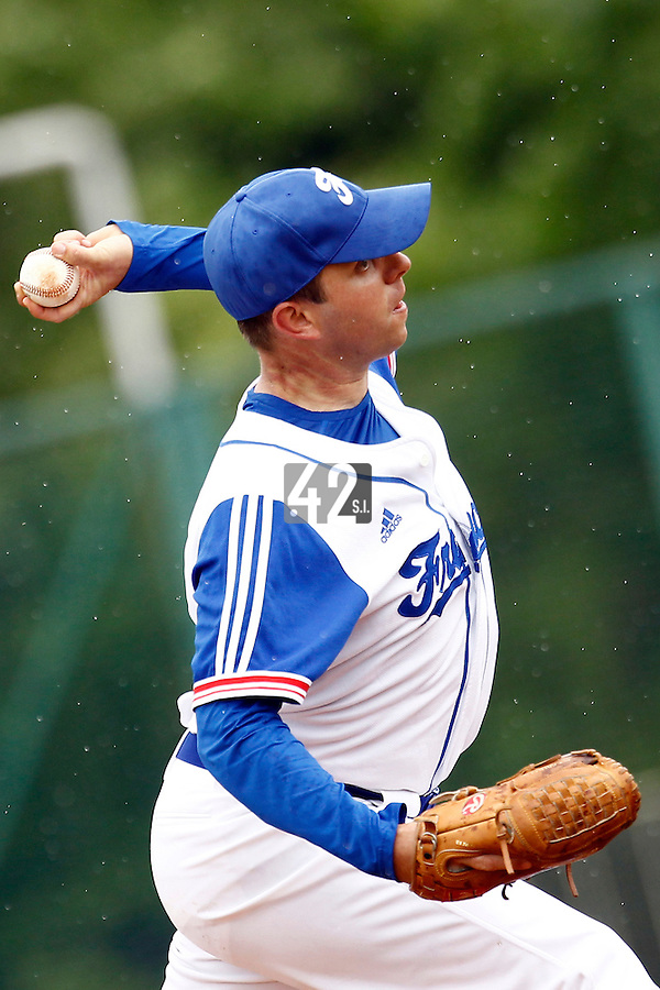21 June 2011: Jerome Debrais of Team France pitches against UCLA Alumni during UCLA Alumni 5-3 win over France, at the 2011 Prague Baseball Week, in Prague, Czech Republic.