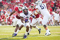 TCU Horned Frogs vs Arkansas Razorbacks –Darius Anderson(6) running the ball up the field as Randy Ramsey (10) tries to catch him from behind at Donald W. Reynolds Razorback Stadium, University of Arkansas,  Fayetteville, AR, on Saturday, September 9, 2017,  © 2017 David Beach