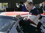 Mark Martin climbs from the No. 6 Ford after a morning run during NASCAR Nextel Cup testing at Daytona International Speedway in Daytona Beach, Fla., Wednesday, January 18, 2006.(AP Photo/Brian Myrick)