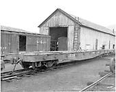Fishbelly flat car #6530 &amp; boxcar #3519 near Durango car shop.<br /> D&amp;RGW  Durango, CO  Taken by Payne, Andy M. - 7/31/1967