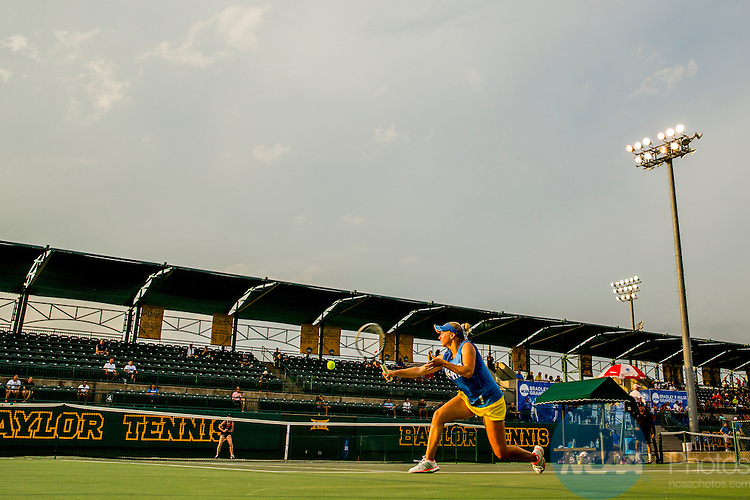 19 MAY 2015:  Catherine Harrison of UCLA hits a backhand in her match against Vanderbilt's Courtney Colton during The Division I Women's Tennis Championship, held at the Hurd Tennis Center on the Baylor University campus in Waco, TX.  Vanderbilt defeated UCLA 4-2 to win the team national title.  Darren Carroll/NCAA Photos