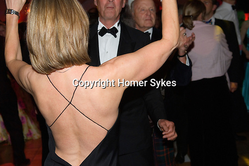 Woman in cocktail party dress dancing with elderly man private party disco Hampshire 2008